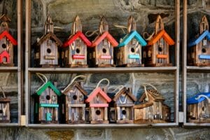 Rows of wooden bird houses, meant to signify the housing market.
